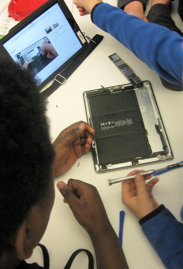 Teens working on an iPad.